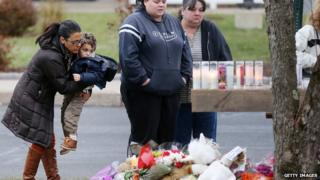 Mourners at a makeshift vigil in Newtown