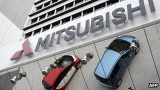 Cars outside a Mitsubishi showroom