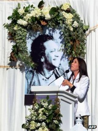 Olivia Harrison, widow of the late ex-Beatle George Harrison, looks skyward following her words to those in attendance for the Ravi Shankar Memorial at the Self Realization Fellowship grounds in Encinitas, California on December 20, 2012.