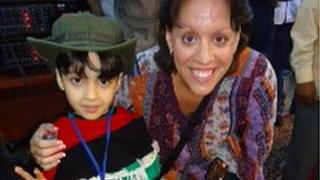 Lisa Gibson with a child in Libya