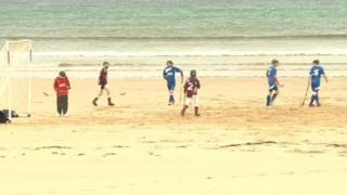 Shinty played on beach