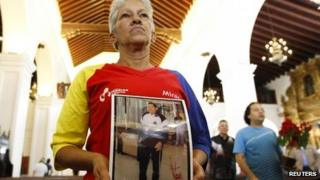 Supporters pray for Mr Chavez at a Mass in Caracas, December 24