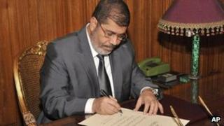 Mohammed Morsi signs the constitution into law, 25 Dec