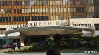 A man walks past the Mount Elizabeth Medical Centre where Indian gang-rape victim will undergo treatment in Singapore December 27, 2012