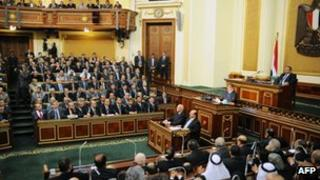President Mohammed Morsi addresses the Egyptian upper house of parliament
