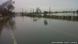 Flooded road near Dunham Bridge