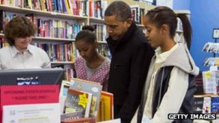 President Barack Obama and daughters Sasha and Malia at a book shop on America's Small Business Saturday