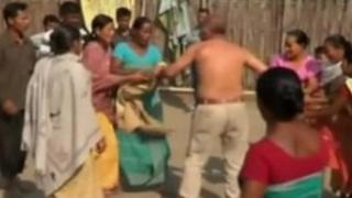 Women strip rape suspect Bikram Singh Brahma in Santipur, Assam, India, 3 January (video grab from Indian TV)
