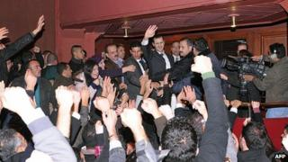 Bashar al-Assad is mobbed at the end of his address