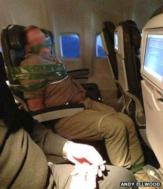 A passenger bound with tape allegedly aboard an Iceland Air flight