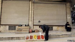 A man sells vegetables on the streets of Aleppo, file pic from 25 December 2012