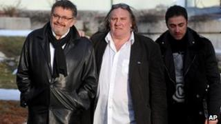 Actor Gerard Depardieu (centre) with Montenegrin Culture Minister Branislav Micunovic (L)