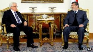 Mohammed Morsi (R) and Mahmoud Abbas, Cairo, 9 January