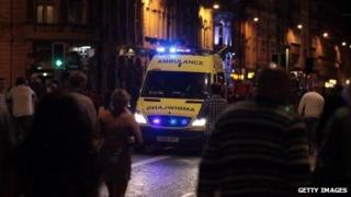 Ambulance and Saturday night revellers in Cardiff