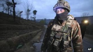 An Indian army soldier patrols near the line of control, the line that divides Kashmir between India and Pakistan, after reported ceasefire violation, in Mendhar, Poonch district, about 210 kilometers (131 miles) from Jammu, India, Wednesday, Jan. 9, 2013.