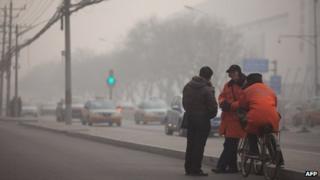 Parking attendants in Beijing on 12 January.