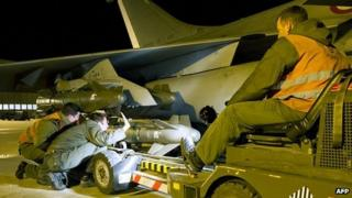 French soldiers equipping a French Rafale fighter with A2SM ammunitions before its departure for a base in Chad