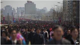 People walk at a military parade in Pyongyang, North Korea (April 2012)