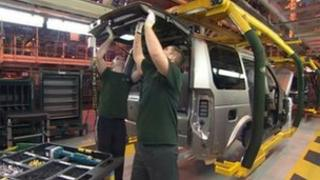 Jaguar Land Rover workers on the production line - archive image
