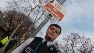 Civil enforcement officer and no smoking sign