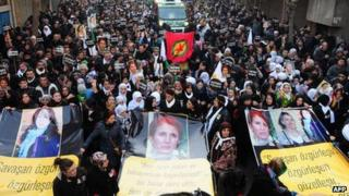 Thousands of Kurds in Diyarbakir carry banners bearing pictures of the three killed PKK activists. Photo: 17 January 2013