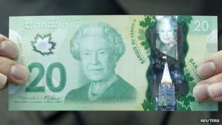 The new Canadian 20 dollar bill made of polymer is displayed at the Bank of Canada in Ottawa 2 May 2012