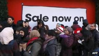 Shoppers queuing outside a shop in central London on Boxing Day