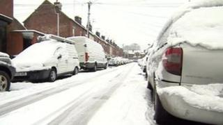 Snow-covered cars in Sheffield