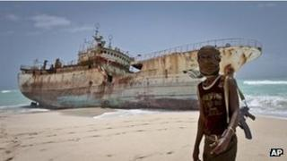 A Somali pirate poses in front of a Taiwanese fishing vessel - photo 23 September