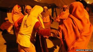 Group of Juna Sanyasini Akhara dancing in a ring