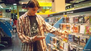 Boy looking at CD