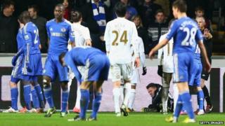 A ball boy lays on the ground after being kicked by Eden Hazard