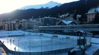 Young people playing ice hockey in Davos