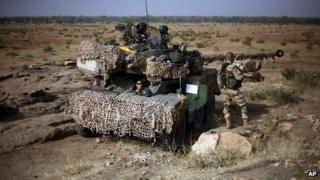 French soldiers man tank at observation post outside Sevare, Mali. 24 Jan 2013