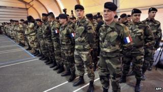 French soldiers are waiting the arrival of the French Defence Minister before their departure to Mali on January 25