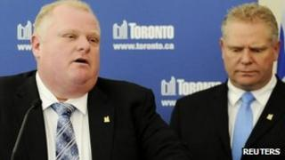 Toronto Mayor Rob Ford speaks to the media at City Hall supported by his brother, Councillor Doug Ford after winning his conflict of interest appeal in Toronto, Ontario, 25 January 2013