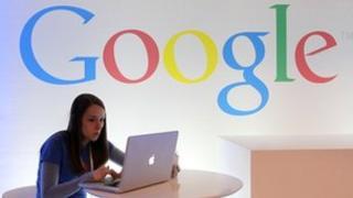 Google logo and woman on Apple computer
