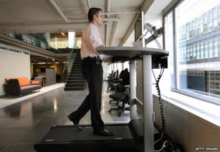 A man at a treadmill desk