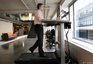 A man at a treadmill desk