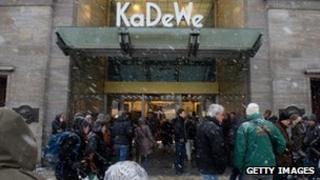 Shoppers mill around KaDeWe in the snow