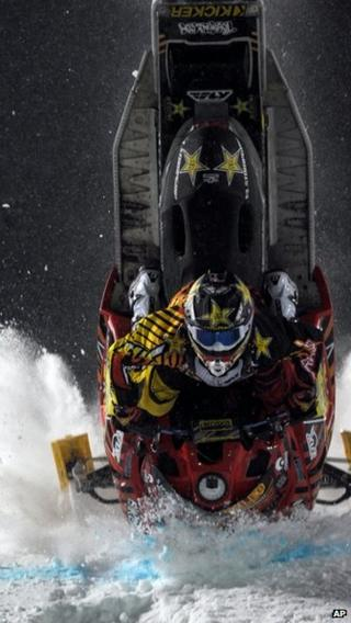 Caleb Moore crashes during the snowmoblie freestyle finals at the Winter X Games in Aspen, Colorado 24 January 2013