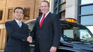 Daniel Li, chairman of Geely UK Group with Matthew Hammond of Pricewaterhouse Coopers