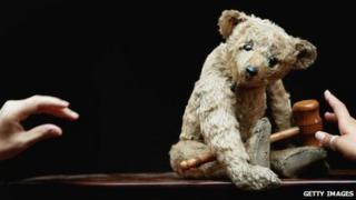 Christie's staff arrange a 1904 Steiff bear, known as Growler, which is believed to be one of the oldest teddy bears in the world