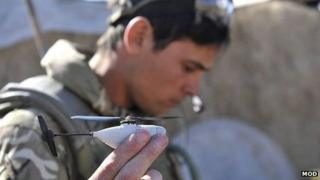 Soldier holds Black Hornet Unmanned Air Vehicle in Afghanistan