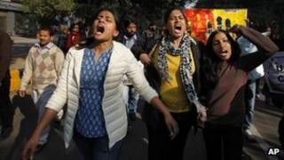 Indian women shout slogans during a protest march against gender discrimination and sexual violence in New Delhi, India, Saturday, Jan. 26, 2013.