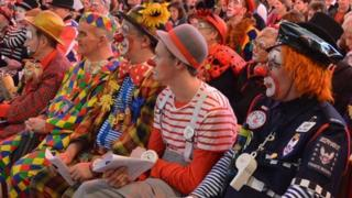 Dozens of clowns attended the church service at Holy Trinity Church in Dalston