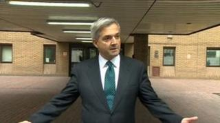 Chris Huhne, announced his resignation outside court