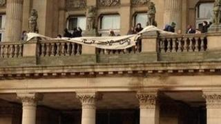 Protestors on the council house balcony