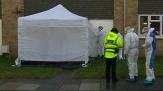 Forensic officers at the scene in Holywell
