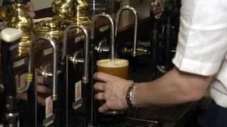 Pint being pulled in a pub